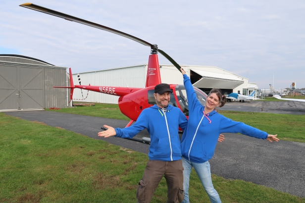 Dennis and Kimberly Goza in front of red helicopter