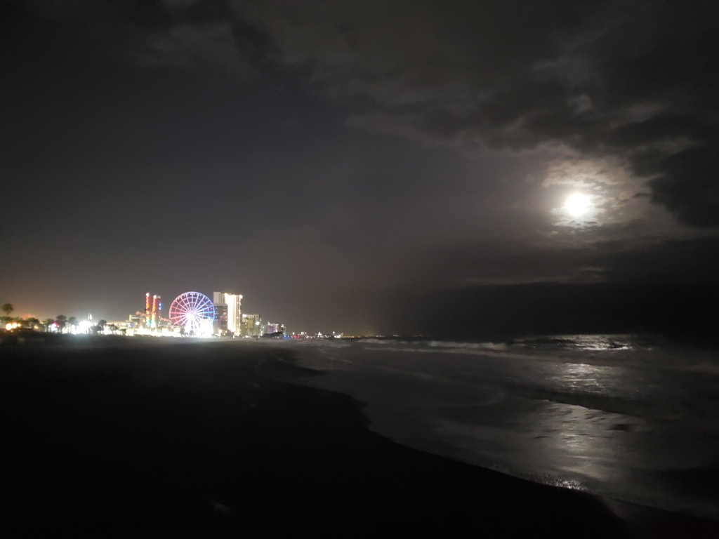 Full moon shines on Myrtle Beach, view of large ferris wheel